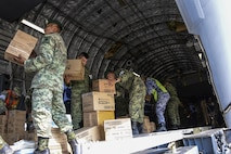 Members of the Mexican army form an assembly line to transfer boxes of hygiene supplies from a U.S. Air Force C-17 Globemaster III to a supply truck Sept. 22 at Ixetepec Airport, Oaxaca, Mexico. At the request of the Mexican government, the C-17 and its six-member crew from Travis Air Force Base, Calif., assisted U.S. efforts to provide humanitarian aid to Mexico by airlifting over 31,000 pounds of hygiene and medical supplies to the area after a 7.1-magnitude earthquake struck Mexico City Sept. 19. (U.S. Air Force photo / 2nd Lt. Sarah Johnson)