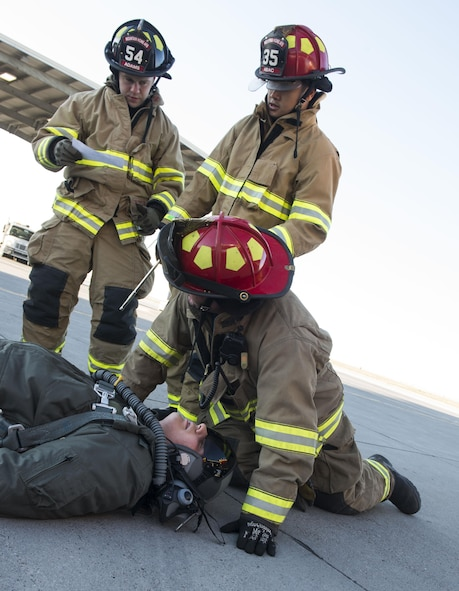 While one airman simulated unconciousness, another fained responsiveness and first responders had to treat their symptoms.
