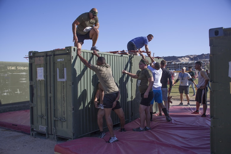 Competitors work together to overcome obstacles during the Combat Center's 65th anniversary Battle of Bandini aboard the Marine Corps Air Ground Combat Center Twentynine Palms, Calif., September 23. To commemorate the event, the Combat Center hosted a variety of festivities, including a street fair, a Family Fun Zone and a contest of physical fitness called the Battle of Bandini. (U.S. Marine Corps photo by Lance Cpl. Natalia Cuevas)