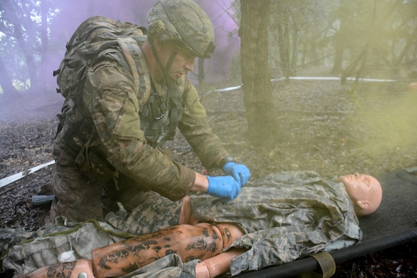 Staff Sgt. Joshua Merriss, 232nd Medical Battalion, treating a simulated burn victim during the tactical combat casualty care lane during the AMEDDC&S Best Medic Completion at Joint Base San Antonio-Camp Bullis Sept. 25-28.