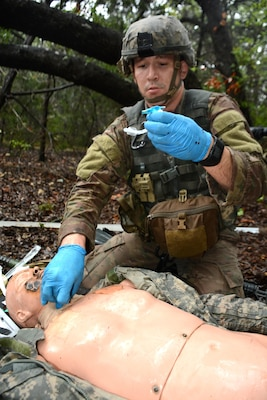 Staff Sgt. Joshua Merriss, 232nd Medical Battalion, prepares a tracheostomy tube for a simulated causality on the tactical combat casualty care lane during the AMEDDC&S Best Medic Completion at Joint Base San Antonio-Camp Bullis Sept. 25-28.