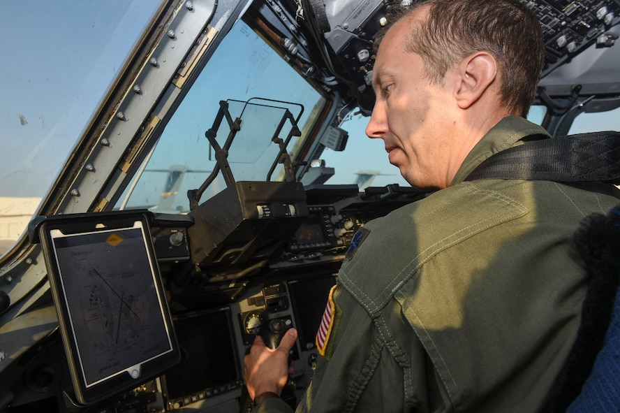 Lt. Col. Thomas Clark, 437th Operations Group deputy chief of standards and evaluations, uses the new Electronic Flight Bag mount modification on the flightline in Joint Base Charleston, S.C., Sept. 29, 2017.
