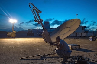 Airmen set up a satellite communication antenna and tactical airfield weather center in Ceiba, Puerto Rico, Sept. 25, 2017. Photos by Air Force Staff Sgt. Robert Hicks