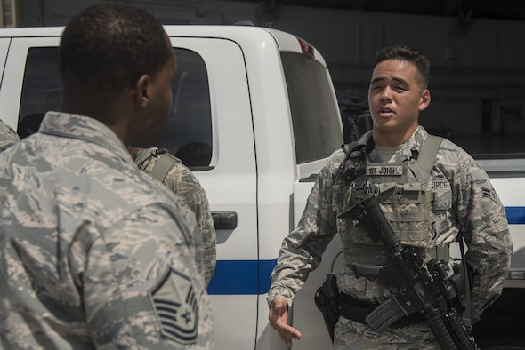 U.S. Air Force Airman 1st Class Randall St. John, an entry controller assigned to the 6th Security Forces Squadron, delivers his post briefing to Master Sgt. Adrian Wright, sustainment services flight superintendent assigned to the 6th Force Support Squadron, at MacDill Air Force Base, Fla., Sept. 21, 2017.