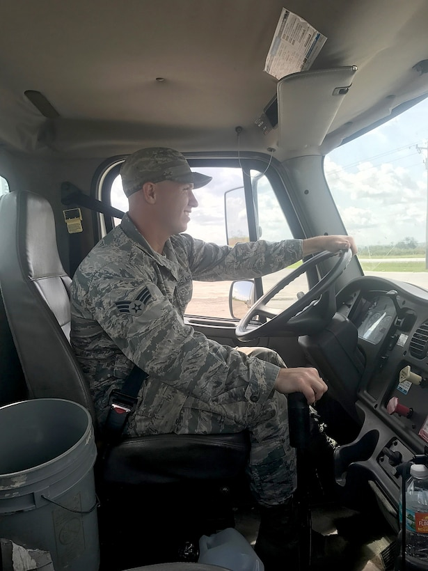 U.S. Air Force Senior Airman Logan T. Patterson, a vehicle operator assigned to the 6th Logistics Readiness Squadron, leads a convoy to recover the President of the United States' assets from West Palm Beach, Sept. 14, 2017.