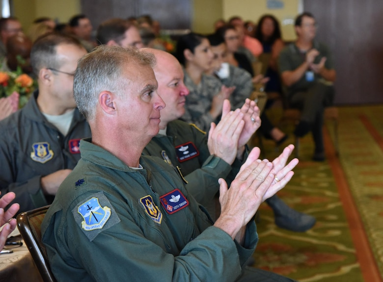 Lt. Col. Keith Gibson, 403rd Operations Group deputy commander, applauds during the Biloxi Chamber Morning Call at the Bay Breeze Event Center Sept. 28, 2017, on Keesler Air Force Base, Mississippi. Local business and community leaders attended the event to learn more about the base's mission and its Airmen. During the event, hosted by the 81st Training Wing, members of the 334th Training Squadron drill team performed and several Keesler Airmen shared their story about why they joined the Air Force. (U.S. Air Force photo by Kemberly Groue)
