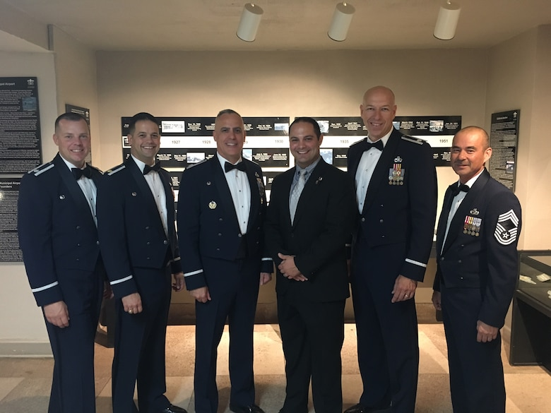 Andrew Nelson (center right), 22nd Maintenance Group honorary commander, poses with 22nd MXG leaders Sep. 16, 2017, at the Air Force Gala at the Wichita Aviation Museum, Kansas. Honorary commanders help Air Force commanders connect with their communities by improving understanding of what the Air Force does and how they help the surrounding cities. (Courtesy photo)