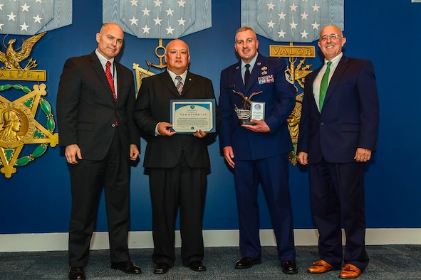 From left to right, The Honorable Kenneth P. Rapuano, Assistant Secretary of Defense for Homeland Defense and Global Security, Bob Cronan, the flight chief of readiness and emergency management, and Master Sgt. Timothy Bricker, the superintendent of the emergent readiness flight, both assigned to the 28th Civil Engineer Squadron, and Mr. Robert G. Salesses, the Deputy Assistant Secretary of Defense for Homeland take a group photo during an award ceremony in the Pentagon Hall of Heroes, Washington, D.C., Sept. 24, 2017. Recognized for their efforts and cooperation, the Airmen of emergency management, explosive ordnance disposal and the fire department worked together to achieve and exceed the national preparedness goal, resiliency throughout the nation. (U.S. Air Courtesy Photo)