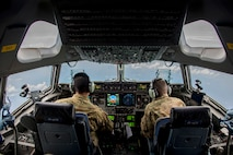 Capt. Bryan Adams, left, and Capt. David Wilfong, 15th Airlift Squadron pilots, fly a C-17 Globemaster III enroute to Puerto Rico, Sept. 9, 2017, to deliver personnel and equipment in support of Hurricane Irma relief operations. (U.S. Air Force photo by Staff Sgt. Charles Rivezzo)