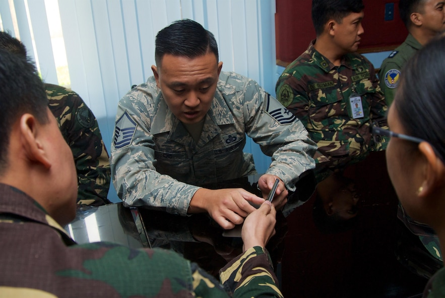 Master Sgt. Michael Cho, a command and control battle management operations craftsman with the 169th Air Defense Squadron is shown a picture of radar equipment