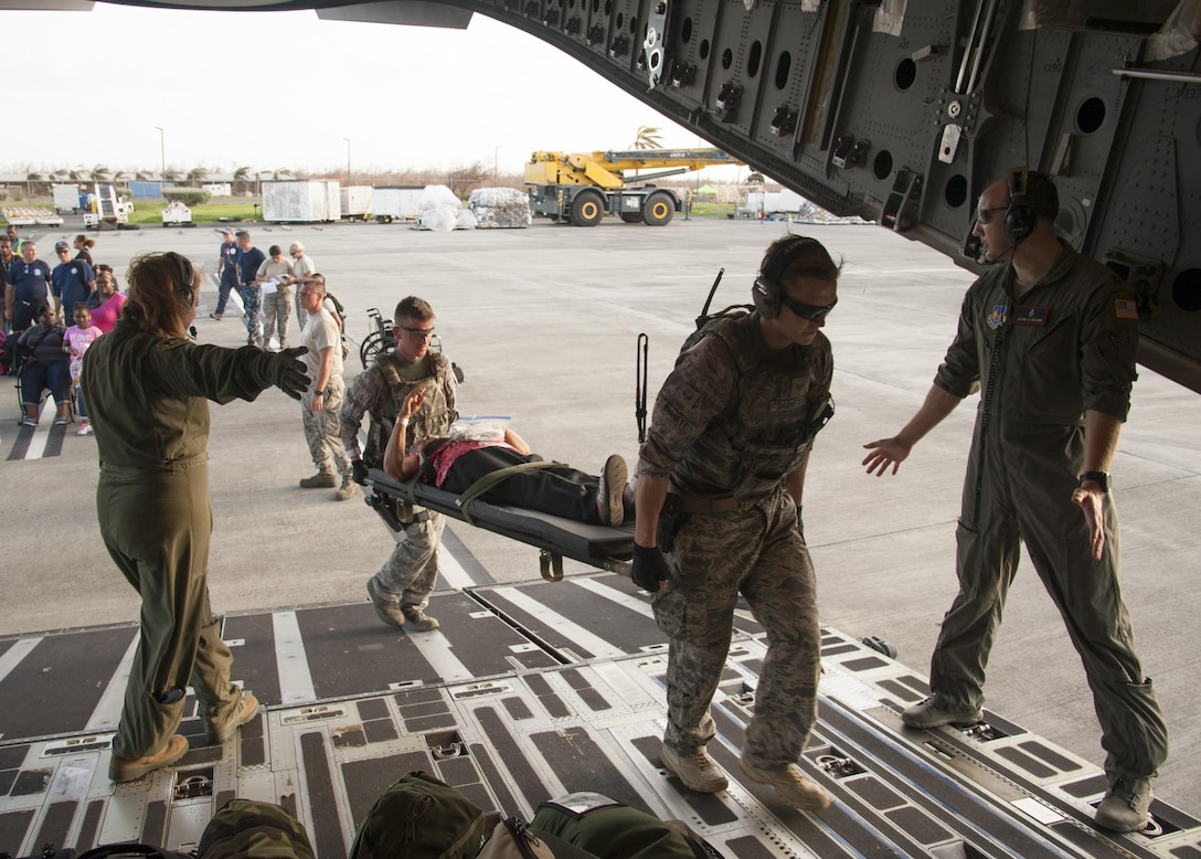 Reserve Citizen Airmen assigned to the 45th Aeromedical Evacuation Squadron, carry patients aboard a C-17 Globemaster III in St. Croix, U.S. Virgin Islands, Sept. 24, 2017. Reserve Citizen Airmen conduct humanitarian mission to St. Croix to evacuate victims affected by Hurricane Maria. (U.S. Air Force photo by Tech. Sgt. Peter Dean)