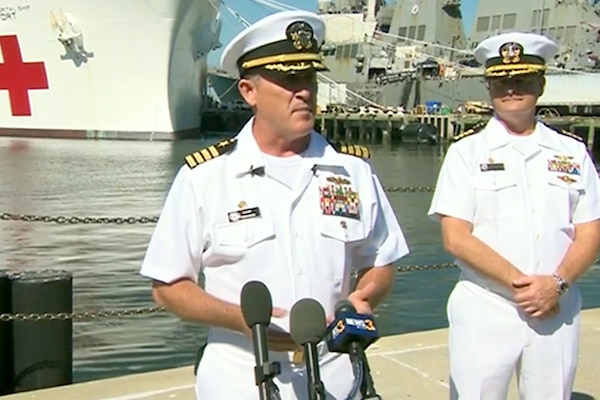 Navy Capts. Kevin Robinson, commander of Military Sealift Command Atlantic and Task Force 83, and Kevin Buckley, commanding officer of the military treatment facility aboard the hospital ship USNS Comfort, brief reporters in Norfolk, Va., before the Comfort departs for Puerto Rico to join humanitarian aid efforts, Sept. 29, 2017. Screenshot via Defense.gov