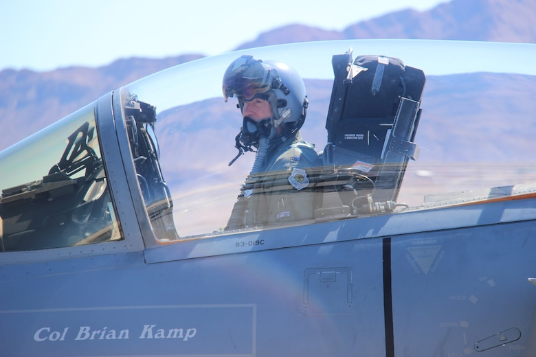 Col. Brian Kamp, Air National Guard advisor to the U.S. Air Force Warfare Center, sits in the cockpit of an F-15C Eagle September 27, 2017, at Nellis Air Force Base, Nevada. Kamp just hit the 4,000-hour mark flying an F-15C. (U.S. Air Force photo by Susan Garcia/Released)
