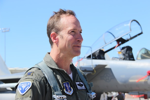 Col. Brian Kamp, Air National Guard advisor to the U.S. Air Force Warfare Center, displays his F-15C Eagle 4,000 flight-hours patch September 27, 2017, at Nellis Air Force Base, Nevada. Kamp has flown more than 3,000 sorties in an F-15C during his 28-year piloting career. (U.S. Air Force photo by Susan Garcia/Released)