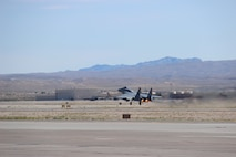 """An F-15C Eagle piloted by Col. Brian """"Spiderman"""" Kamp, Air National Guard advisor to the Air Force Warfare Center, takes off from the runway September 27, 2017, at Nellis Air Force Base, Nevada. Kamp's 4,000 flight-hours is equivalent to more than 165 continuous days piloting the F-15C. (U.S. Air Force photo by Susan Garcia/Released)"""