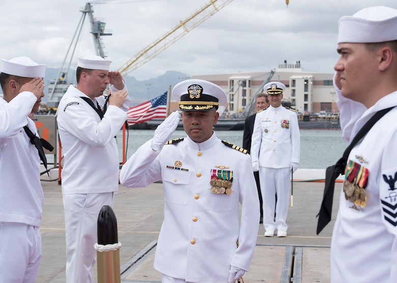 Capt. Albert Alarcon is piped aboard the Los Angeles-Class Attack submarine USS Columbus (SSN 762) for his change of command ceremony, Sept. 21. (U.S. Navy Photo by Mass Communication Specialist 2nd Class Shaun Griffin/Released)
