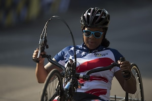 Army Spc. Stephanie Morris powers a hand cycle during the morning start of cycling at the 2017 Invictus Games in Toronto, Sept. 27, 2017. DoD photo by EJ Hersom