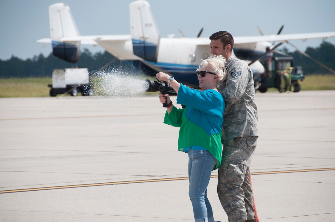 Jyl Cline, wife of Col. John Cline, deputy director of operations, Air Force Special Operations Command, prepares to hose down her husband