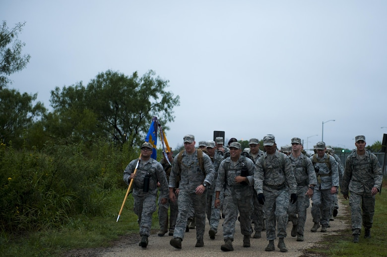Volunteers, led by U.S. Air Force Senior Master Sgt. Russell Weatherby, 17th Security Forces Squadron individual mobilization augmenter, march the perimeter road during the Jacobson ruck march on Goodfellow Air Force Base, Texas, Sept. 28, 2017. Jacobson was killed in action on Sept. 28, 2005, on patrol near the Iraqi town of Safwan. Her vehicle was hit by an improvised explosive device, killing her and U.S. Army Sgt. Steve Mornin. She was the first security forces Airman and first female Airman to die in Operation Iraqi Freedom. Weatherby led Jacobson's fire team and was present the day it all happened. (U.S. Air Force photo by Senior Airman Scott Jackson/Released)