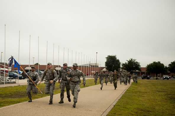 Volunteers run to the finish on the parade field during the Jacobson ruck march on Goodfellow Air Force Base, Texas, Sept. 28, 2017. The volunteers came from all over base to march in honor of Airman 1st Class Elizabeth Jacobson. (U.S. Air Force photo by Senior Airman Scott Jackson/Released)