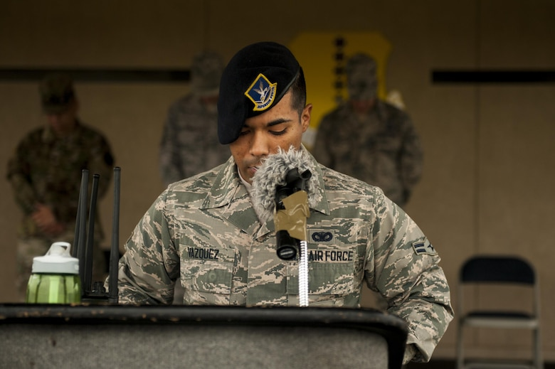 U.S. Air Force Airman 1st Class Luis Vazquez, 17th Security Forces Squadron installation entry controller, finished the Jacobson ruck march with a prayer on the parade filed at Goodfellow Air Force Base, Texas, Sept. 28, 2017. The march went around Goodfellow's perimeter and each volunteer carried 21 lbs symbolizing Jacobson's age at the time of her death. (U.S. Air Force photo by Senior Airman Scott Jackson/Released)