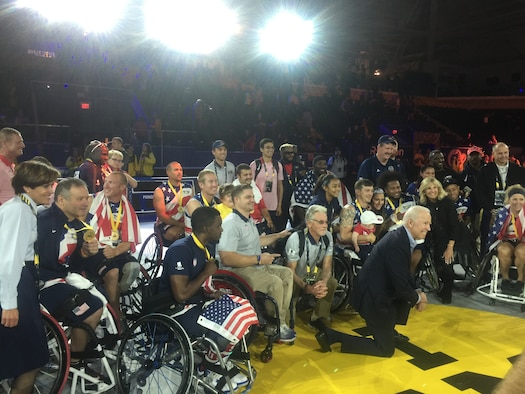 "U.S. Lt. Gen. Gina Grosso (far left), Air Force Deputy Chief of Staff for Manpower and Personnel Services, stands several members of Team U.S. and Joseph Robinette ""Joe"" Biden Jr. (kneeling center), 47th Vice President of the United States, at the 2017 Invictus Games in Toronto, Canada, Sept. 29, 2017. The Invictus Games were established by Prince Harry of Wales in 2014, and have brought together wounded and injured veterans from 17 nations to compete across 12 adaptive sporting events. (Courtesy photo)"