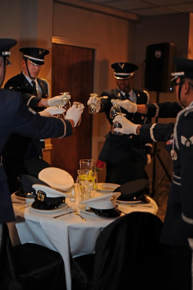 Members of the Laughlin Honor Guard set the POW/MIA dinner table at the Air Force Ball on Laughlin Air Force Base, Texas, Sept. 30, 2017.  The POW/MIA table is an observance for the military's brothers and sisters-in-arms who were prisoners of war or missing in action during any time of conflict.
