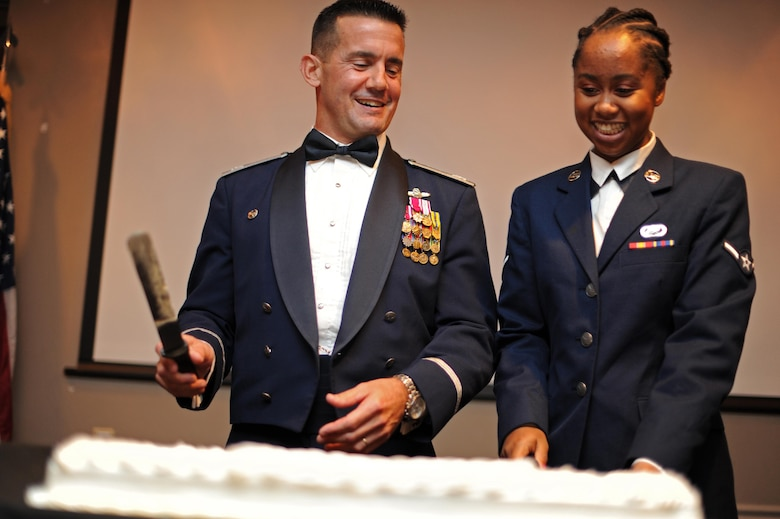 Col. Charles Velino, 47th Flying Training Wing commander and Airman Brittany Zipperian, 47th Force Support Squadron apprentice, cut the first slice of cake at the Air Force Ball at Laughlin Air Force Base, Texas, Sept. 30, 2017.  Traditionally, the oldest and youngest attendants to the ball cut the first slice of cake.