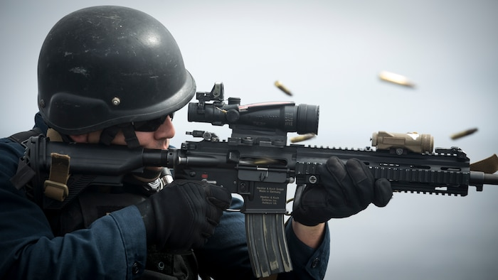 U.S. Navy FC1 Kirk Mills with the Whidbey Island-class amphibious dock landing ship USS Rushmore  conducts live-fire training during an amphibious squadron and Marine Expeditionary Unit integration exercise at sea, March 31, 2018.