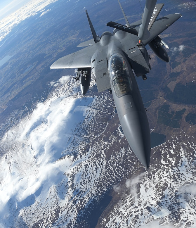 A U.S. Air Force F-15E Strike Eagle assigned to the 492nd Fighter Squadron, RAF Lakenheath, receives fuel from a U.S. Air Force KC-135 Stratotanker from the 100th Air Refueling Wing over Scotland, March 29, 2018. The Strike Eagle was one of eight F-15Es to receive fuel while on a training sortie. (U.S. Air Force photo by Airman 1st Class Benjamin Cooper)