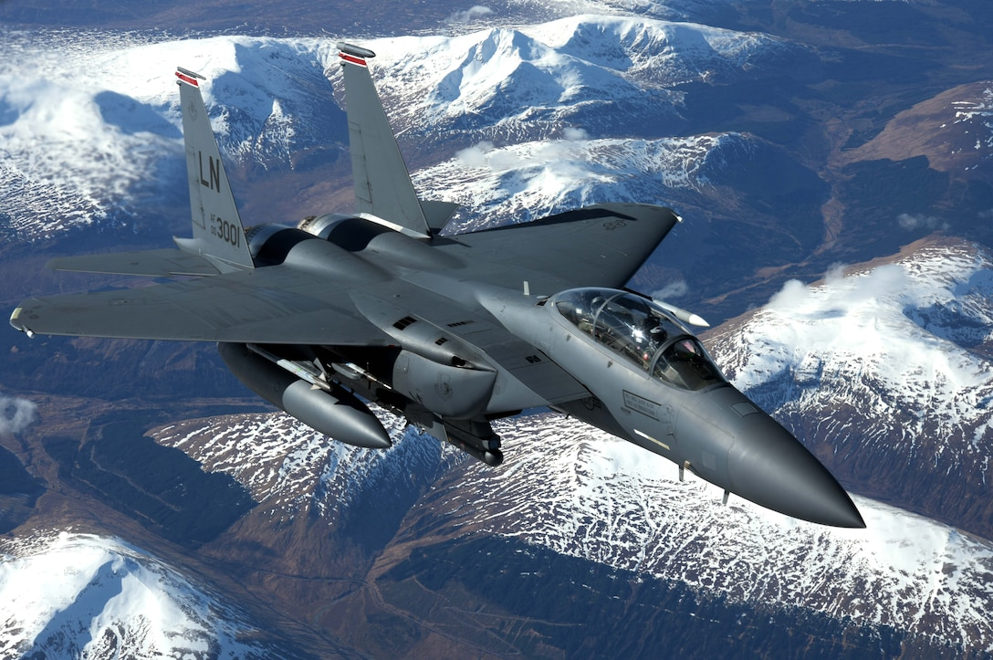 A U.S. Air Force F-15E Strike Eagle assigned to the 494th Fighter Squadron, RAF Lakenheath, flies alongside a U.S. Air Force KC-135 Stratotanker from the 100th Air Refueling Wing over Scotland, March 29, 2018. The Strike Eagle was one of eight F-15Es to receive fuel while on a training sortie. (U.S. Air Force photo by Airman 1st Class Benjamin Cooper)