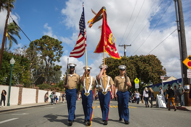 Marines and Sailors with 1st Battalion, 11th Marine Regiment, 1st Marine Division, march in the 60th Swallows Day Parade on March 24, 2018.