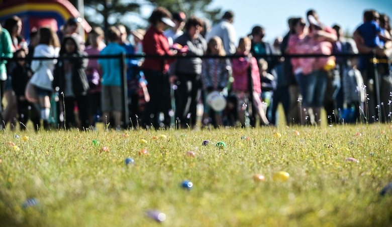 Easter eggs are scattered across a field during a Month of the Military Child celebration at Shaw Air Force Base, S.C., March 31, 2018.