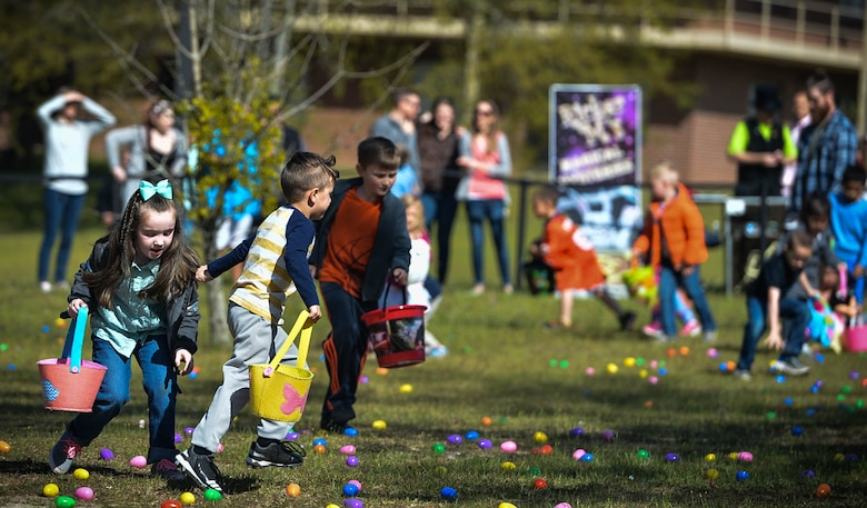 Team Shaw children hunt for Easter eggs during a Month of the Military Child (MOMC) celebration at Shaw Air Force Base, S.C., March 31, 2018.