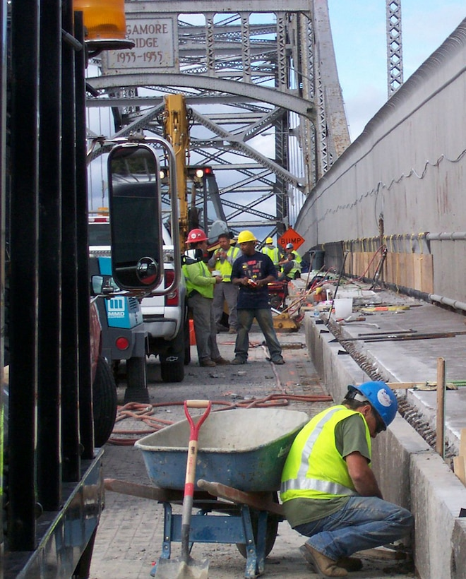 Contractors perform work on the Sagamore Bridge in this September 9, 2009 photo.