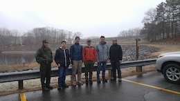 Park Ranger Nicole Giles, Professor Justin Sauvageau and students from Shepherd Hill Regional High School brave the bad weather to install Wood Duck Boxes, Feb. 20, 2018.