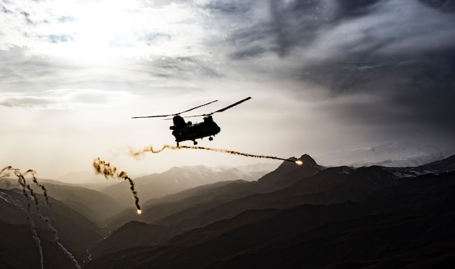A U.S. Army CH-47F Chinook, assigned to Task Force Brawler, releases flares while conducting a training exercise with a Guardian Angel team assigned to the Air Force 83rd Expeditionary Rescue Squadron at Bagram Airfield, Afghanistan, March 26, 2018. The Army crews and Air Force Guardian Angel teams conducted the exercise to build teamwork and procedures as they provide joint personnel recovery capability, aiding in the delivery of decisive airpower for U.S. Central Command. (U.S. Air Force courtesy photo)
