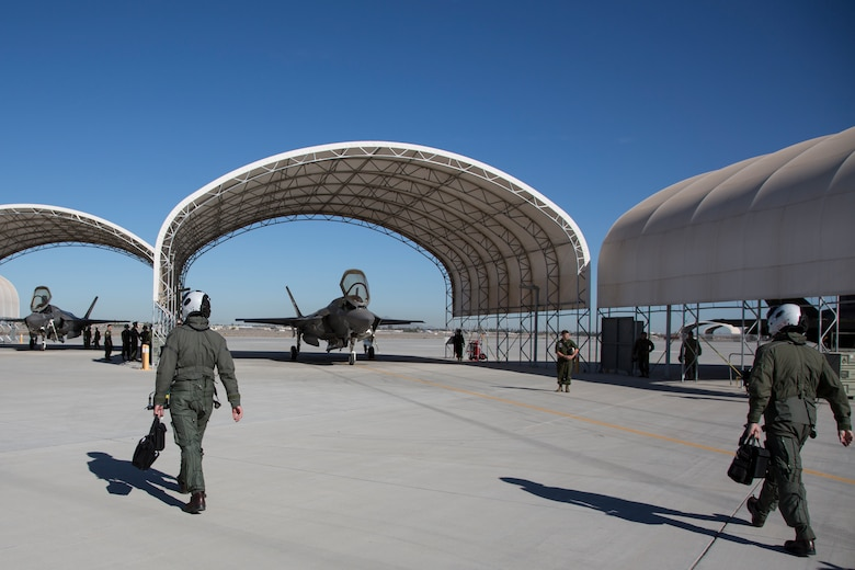 The Commanding Officer of Marine Fighter Attack Squadron 122 (VMFA-122), Lt. Col. John P. Price, and Maintenance Officer of VMFA-122, Maj. Christopher J. Kelly, prepare for VMFA-122's first flight operations in an F-35B Lightning II on Marine Corps Air Station (MCAS) Yuma, Ariz., March 29, 2018. VMFA-122 is conducting the flight operations for the first time as an F-35 squadron.