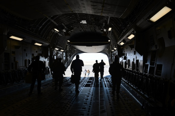 McChord field Airmen walk off of a C-17, March 16, 2018, at Moses Lake, Wash. The Airmen were there to give briefings and perform safety inspections.