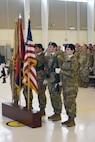 A team of five women from the 1st Combat Aviation Brigade Color Guard led by Sgt. 1st Class Laura Peña, Headquarters and Headquarters Company, 1st CAB, 1st Infantry Division, stands at attention during the Women's History Month Observance March 21 at the Grey Eagle Hangar. The observation was hosted by the Soldiers of the 1st CAB.