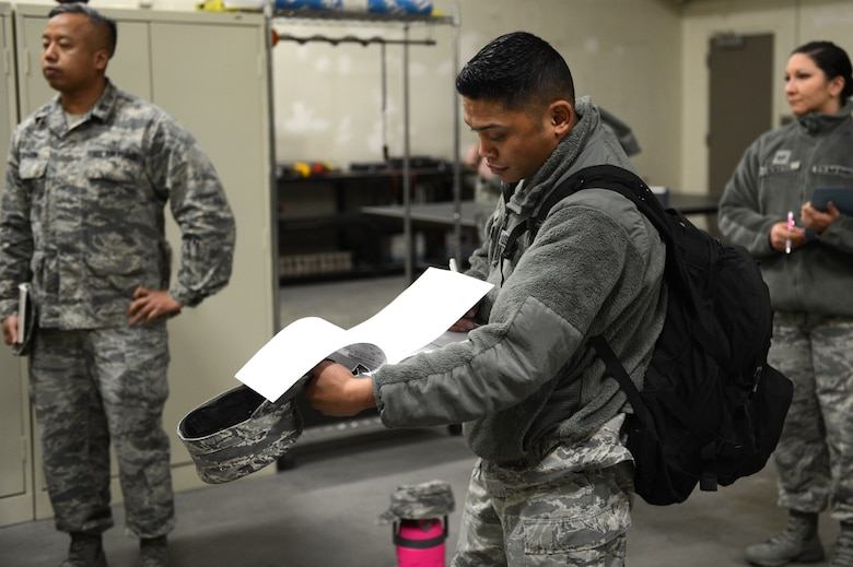 Staff Sgt. Jerry-Lee Calalang, 62nd Medical Squadron, Occupational Health NCOIC, fills out a health and safety inspection form, March 16, 2018, at Moses Lake, Wash. Inspections are performed annually to ensure that facilities and practices remain safe.
