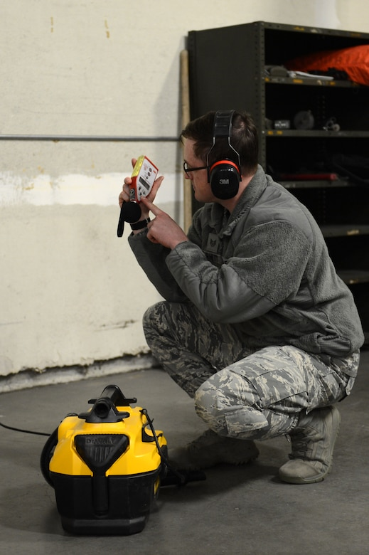 Staff Sgt. Tim Burnett, 62nd Medical Squadron, bioenvironmental engineer, uses a sound level meter to determine the noise level that a portable vacuum makes, March 16, 2018, at Moses Lake, Wash. Machines loud enough to cause hearing damage were labeled with a sticker reminding users to wear ear protection.