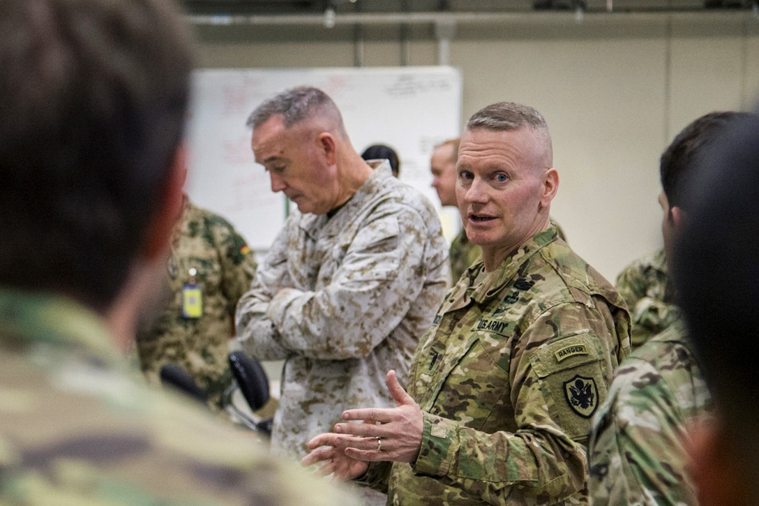 Army Command Sgt. Maj. John W. Troxell, senior enlisted advisor to the chairman of the Joint Chiefs of Staff, addresses U.S. service members.