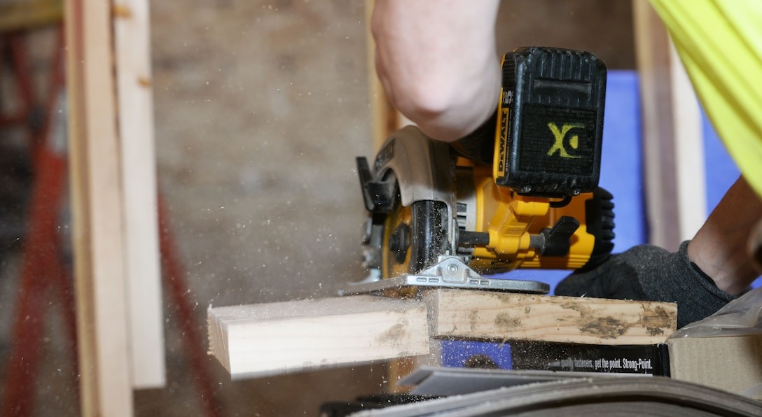 Rick Williams, a carpenter contracted by the Department of Defense, cuts a piece of wood at a dormitory construction site on Ellsworth Air Force Base, S.D., March 27, 2018. The new dormitories began construction January 2017 and are projected to be completed January 2019 at a cost of approximately $21.5 million. (U.S. Air Force photo by Airman 1st Class Thomas Karol)