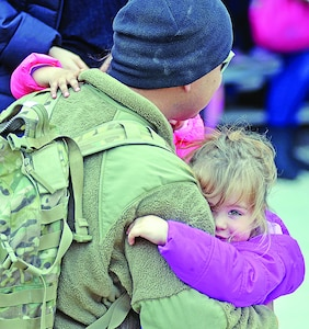 Spc. Asa Manor, Company A, 2nd Combined Arms Battalion, 137th Infantry Regiment, 155th Armored Combat Team, Kansas Army National Guard, is greeted by his 3-year-old daughter, Brynn, during Family Day March 24.