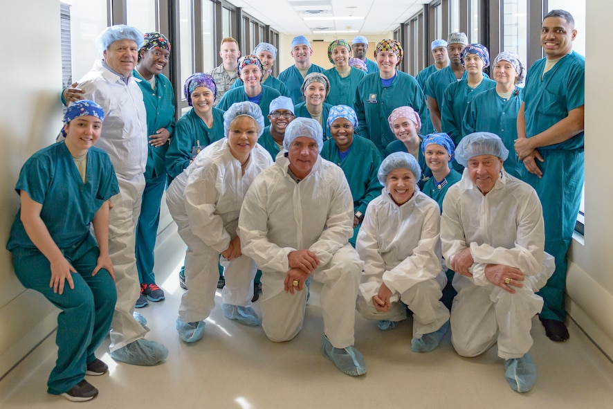 Harry Gant and Jeff Hammond pose for a photo with the surgical robotics suite staff during a visit at Keesler Medical Center March 30, 2018, on Keesler Air Force Base, Mississippi. Hammond and Gant spent the day meeting veterans at the Armed Forces Retirement Home and toured various facilities that support veterans on Keesler Air Force Base. Gant is a former NASCAR driver and Hammond is a current TV broadcaster for the motorsport. (U.S. Air Force photo by Andre' Askew)