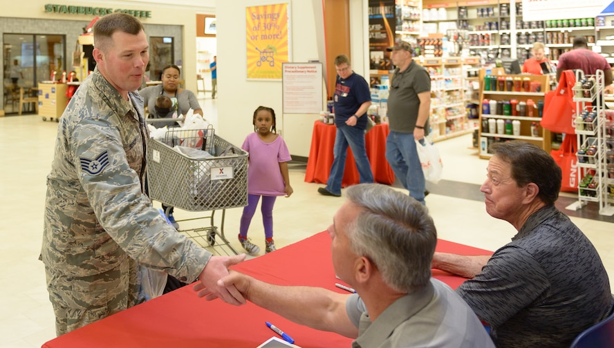U.S. Air Force Staff. Sgt. Brian Bishop, 85th Engineering Installation Squadron radio frequency transmissions technician, shakes hands with Jeff Hammond during the meet and greet at The Exchange March 30, 2018, on Keesler Air Force Base, Mississippi. Hammond and Gant spent the day meeting veterans at the Armed Forces Retirement Home and toured various facilities that support veterans on Keesler Air Force Base. Gant is a former NASCAR driver and Hammond is a current TV broadcaster for the motorsport.