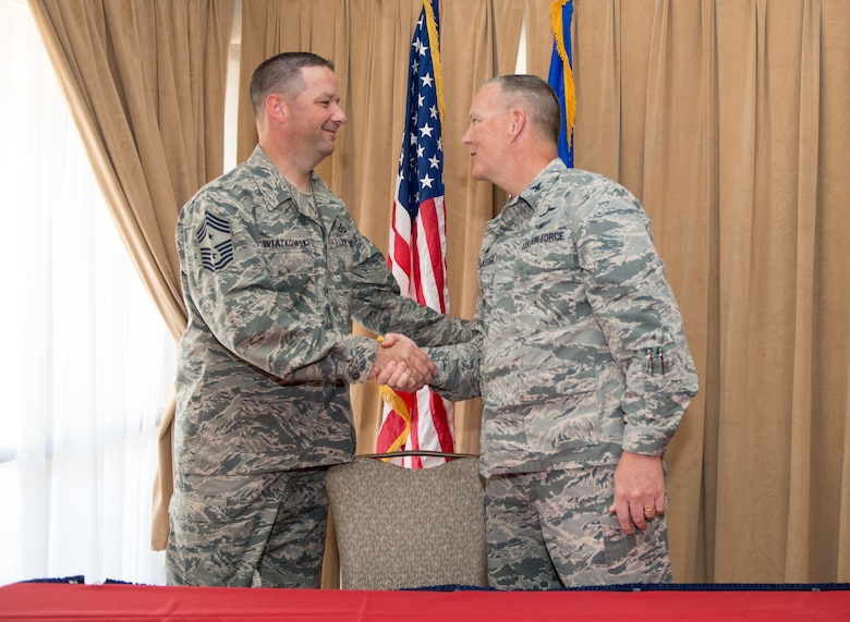 Chief Master Sgt. Randy Kwiatkowski, 56th Fighter Wing command chief, and Col. Robert Sylvester, 56th Mission Support Group commander, shake hands after signing the Air Force Assistance Fund donation forms during the AFAF campaign kickoff breakfast at Luke Air Force Base, Ariz., April 2, 2018. The event officially started the six-week campaign at Luke, designed to provide support to Air Force personnel and their families. (U.S. Air Force photo by Airman 1st Class Alexander Cook)