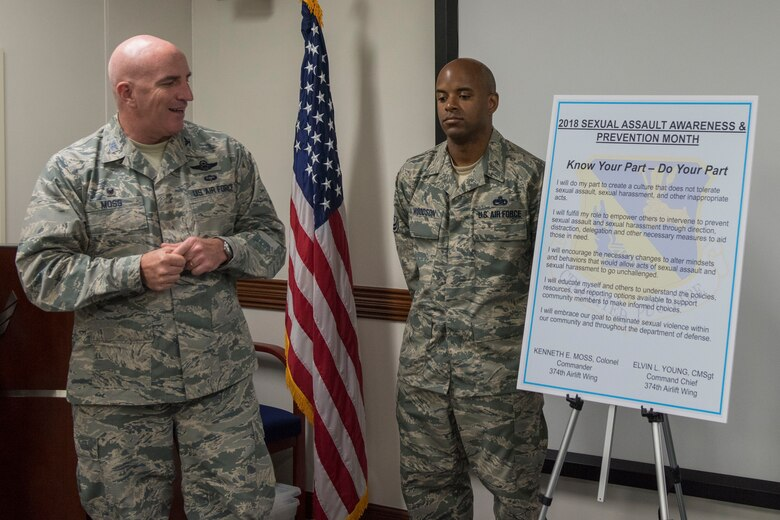Col. Kenneth E.  Moss, 374th Airlift Wing commander, takes a moment to read over the Sexual Assault Awareness & Prevention Month proclamation at Yokota Air base Japan, April 3, 2018.