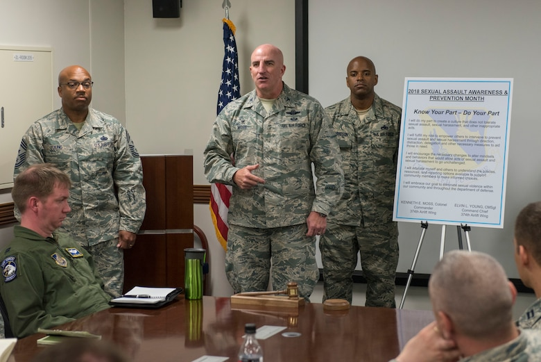 Col. Kenneth E. Moss, 374th Airlift Wing commander, takes a moment to encourage those in attendance to take the Sexual Assault Awareness & Prevention Month proclamation at Yokota Air Base, Japan, April 3, 2018.